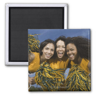 Three female cheerleaders holding pompoms magnet