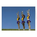 Three female cheerleaders standing in row greeting card