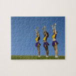Three female cheerleaders standing in row jigsaw puzzle