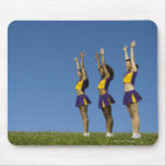 Three female cheerleaders standing in row mouse pad