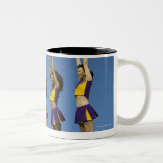 Three female cheerleaders standing in row Two-Tone coffee mug