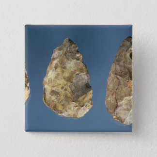 Three flint tools 15 cm square badge
