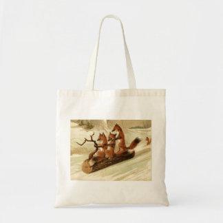 Three Foxes Sledding on a Log Tote Bag