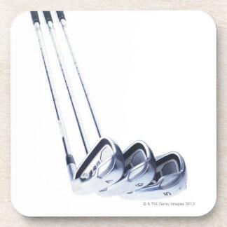 Three golf clubs on white background coaster