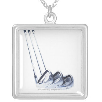 Three golf clubs on white background silver plated necklace