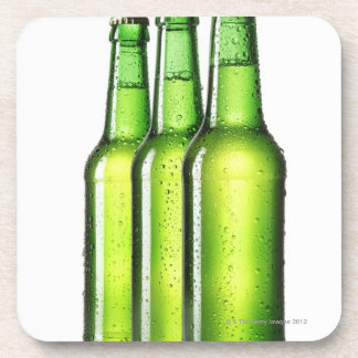 Three green bottles of beer on white background, coaster