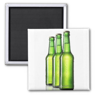Three green bottles of beer on white background, magnet