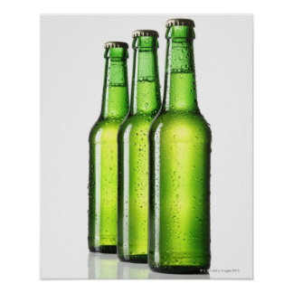 Three green bottles of beer on white background, print