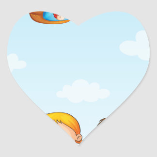 Three kids playing below an airship heart sticker