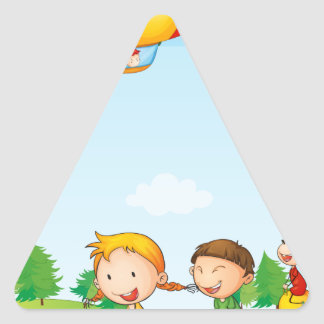 Three kids playing below an airship triangle sticker