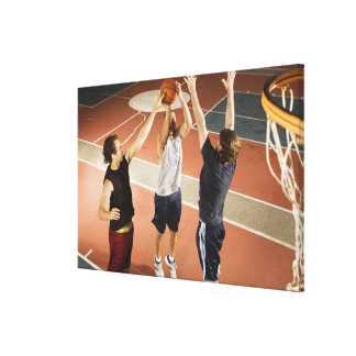 three men in athletic clothing playing canvas prints