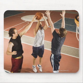three men in athletic clothing playing mouse pad