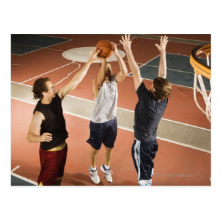 three men in athletic clothing playing postcard