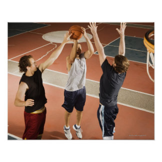 three men in athletic clothing playing posters