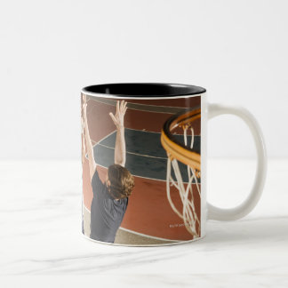 three men in athletic clothing playing Two-Tone mug