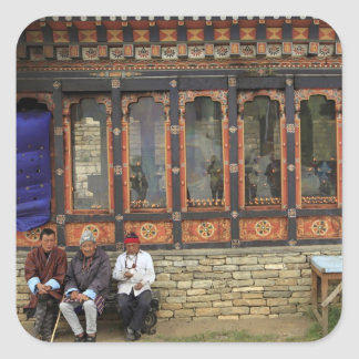 Three men sit on a bench at the Memorial Chorten Square Sticker
