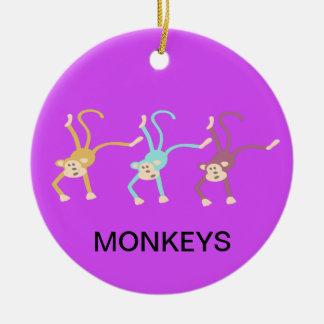 Three monkeys playing christmas ornament