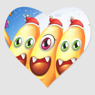 Three monsters celebrating christmas heart sticker