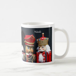 Three nutcrackers on black mug