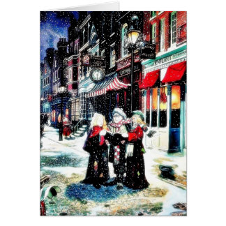 Three persons standing on a street singing christm card