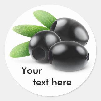 Three pitted black olives round sticker