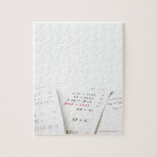 Three receipts on white background. There are Puzzles
