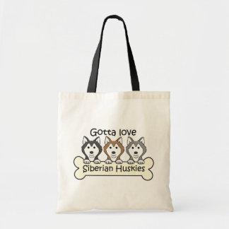 Three Siberian Huskies Tote Bag