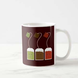 Three smiling tea bags coffee mugs