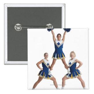 three teenage caucasian female cheerleaders in 15 cm square badge