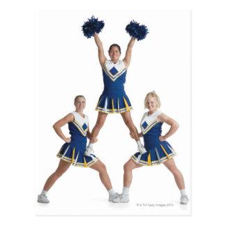 three teenage caucasian female cheerleaders in postcard