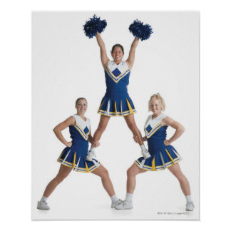 three teenage caucasian female cheerleaders in poster
