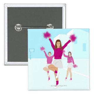 Three teenage cheerleaders holding pom poms 2 15 cm square badge