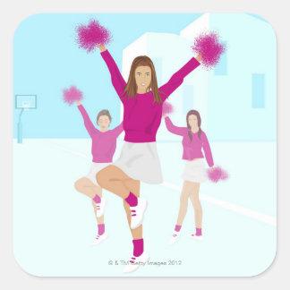 Three teenage cheerleaders holding pom poms 2 square sticker