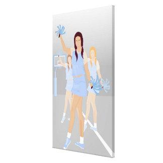 Three teenage cheerleaders holding pom poms canvas print
