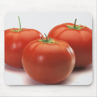 Three tomatoes on counter, close-up mouse pad