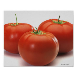 Three tomatoes on counter, close-up poster