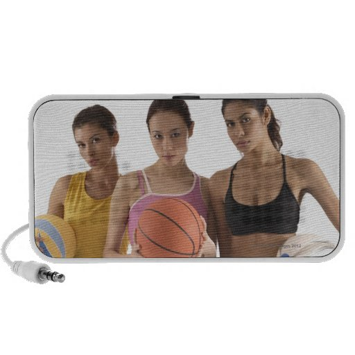 three women of different race, holding travel speakers