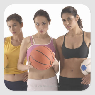 three women of different race, holding square sticker