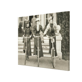 Three women on bicycles, early 1900s (b/w photo) canvas print