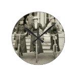 Three women on bicycles, early 1900s (b/w photo) round clock