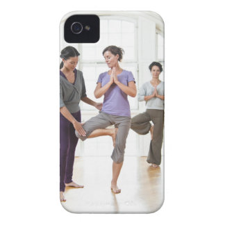 Three women practicing yoga iPhone 4 case