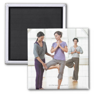 Three women practicing yoga magnet
