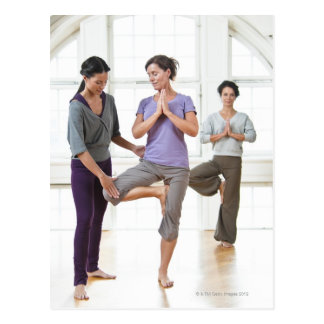 Three women practicing yoga postcard