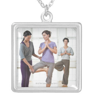 Three women practicing yoga silver plated necklace