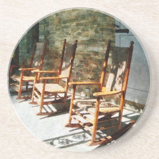 Three Wooden Rocking Chairs on Sunny Porch Coaster