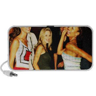 Three young women dancing laptop speakers