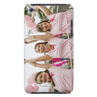Three young women dressed in pink run in iPod touch cover
