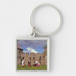 Three young women in traditional clothes keychains