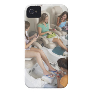 Three young women receiving pedicure in beauty Case-Mate iPhone 4 case