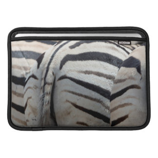 Three zebra tails and behinds MacBook sleeve